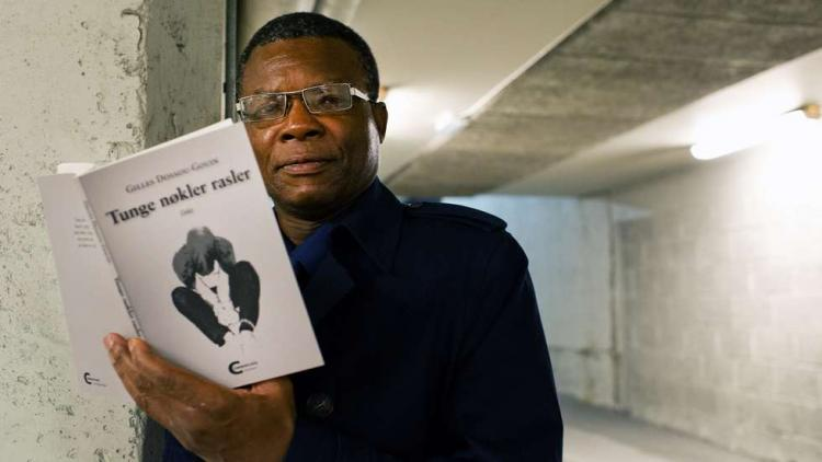 Gilles Dossou-Gouin was Moldes first ICORN writer-in-residence. He sadly passed away 30 September. Here with his latest poetry collection written in Norwegian. Foto: Kjell Langmyren. Photo.